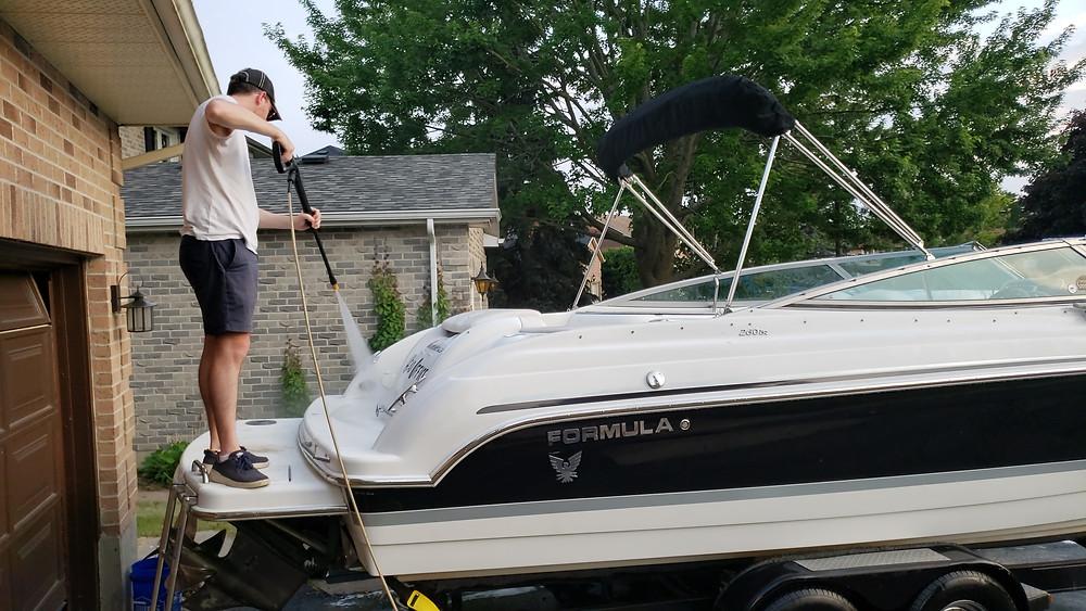 Boat on trailer in driveway