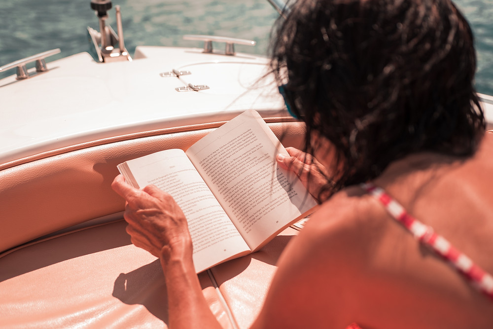 Reading a book on boat deck