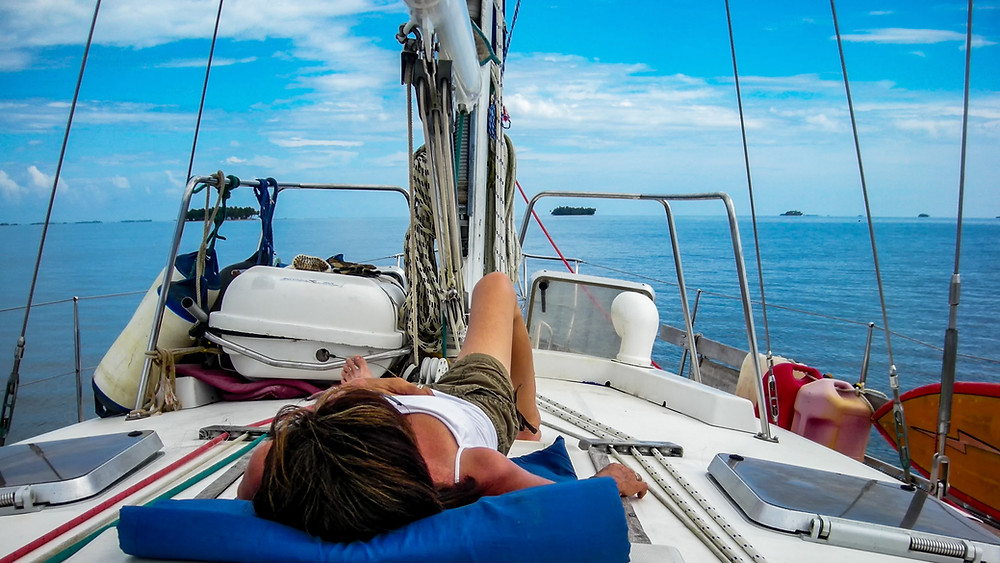 Relaxing on deck of sailboat