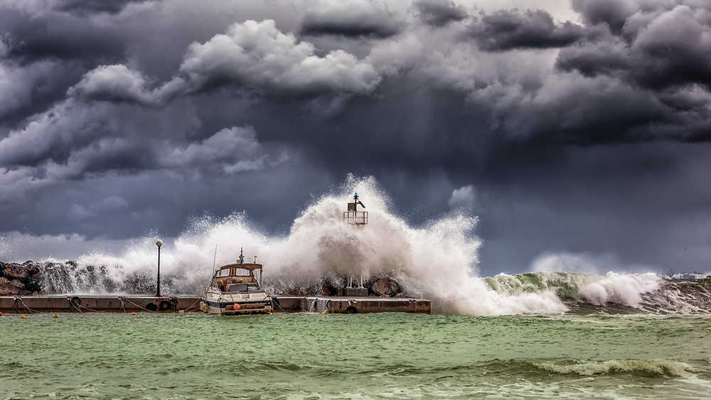 Boat harbour being hit by storm wave