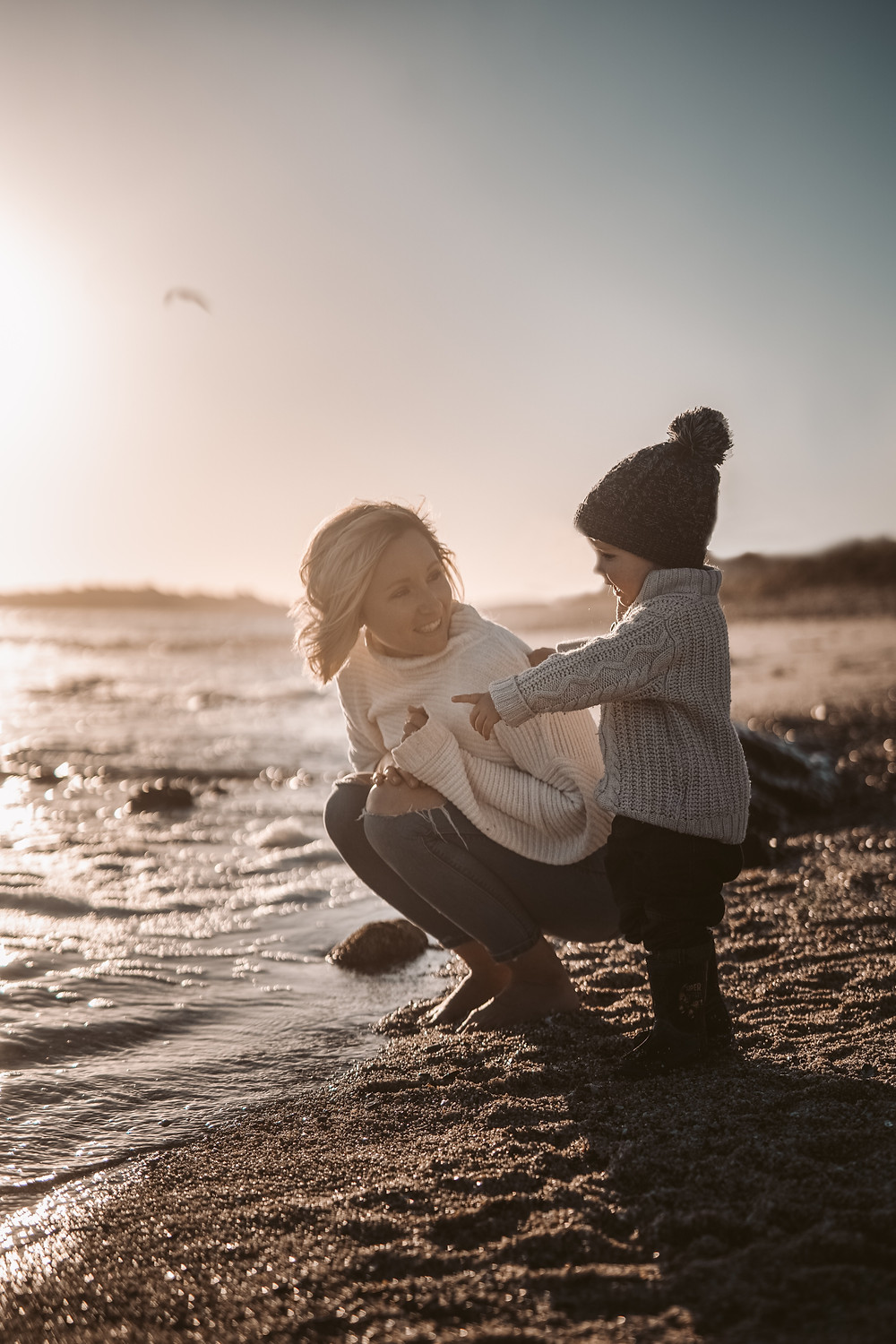Mother and child at beach