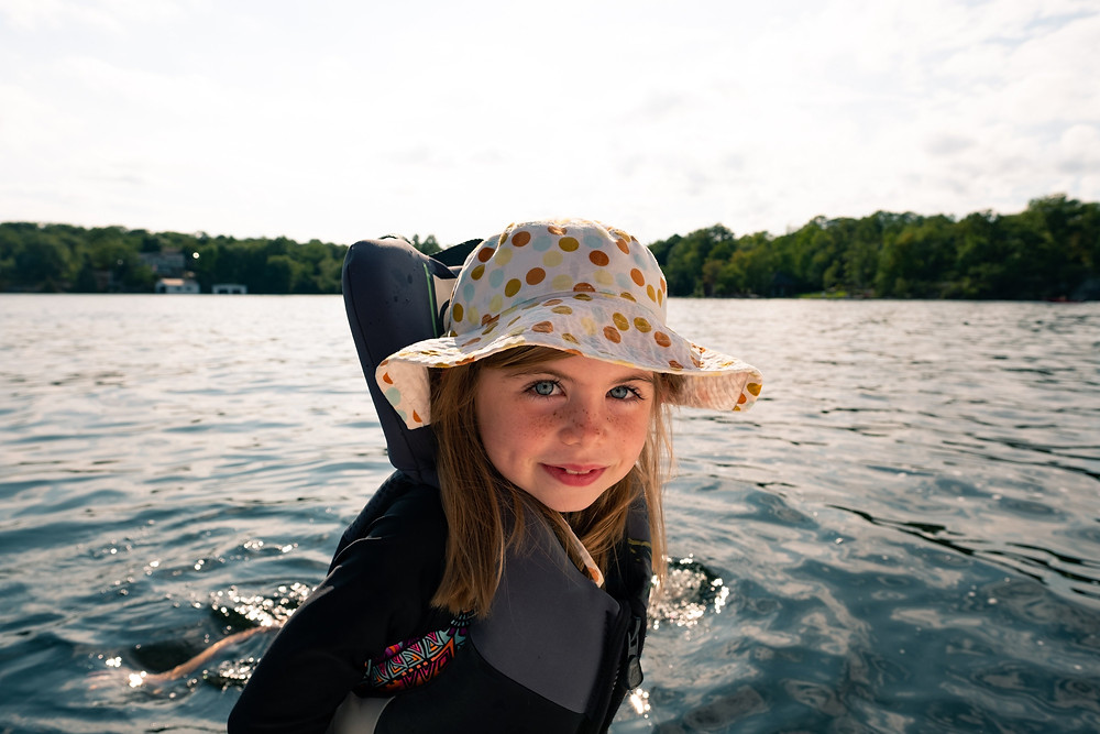 Young girl wearing PFD on boat