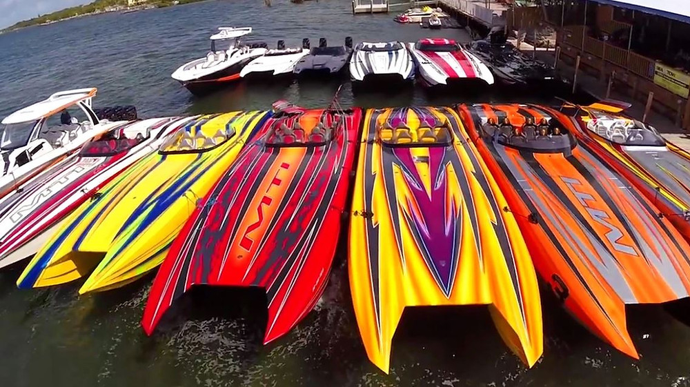 Offshore powerboats tied up at dock