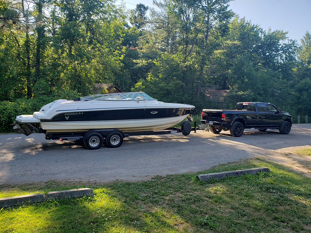 Boat on trailer at launch ramp