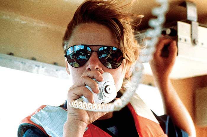 Boat captain using radio