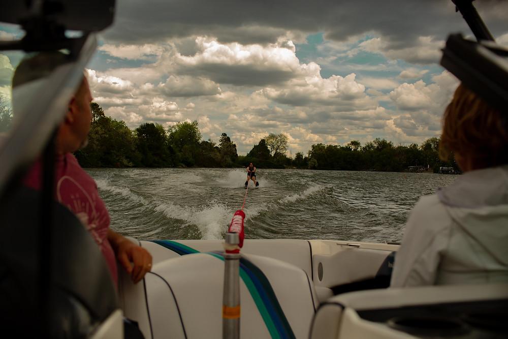 Waterskiier towed behind boat
