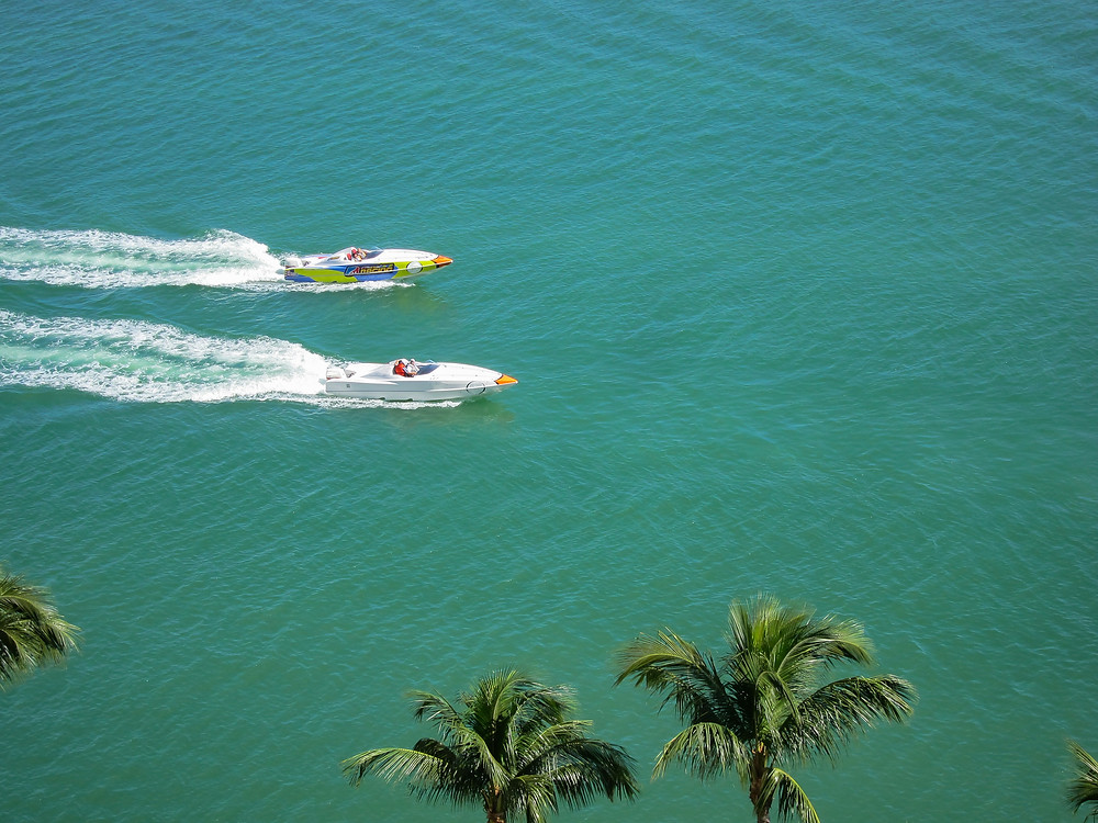 Two racing boats traveling at high speed
