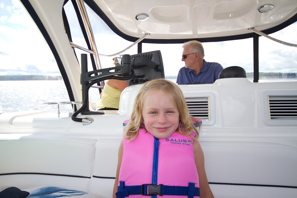 Child wearing PFD on boat