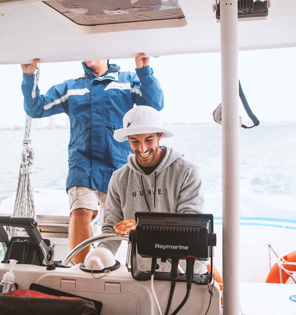 Boat captain at helm smiling