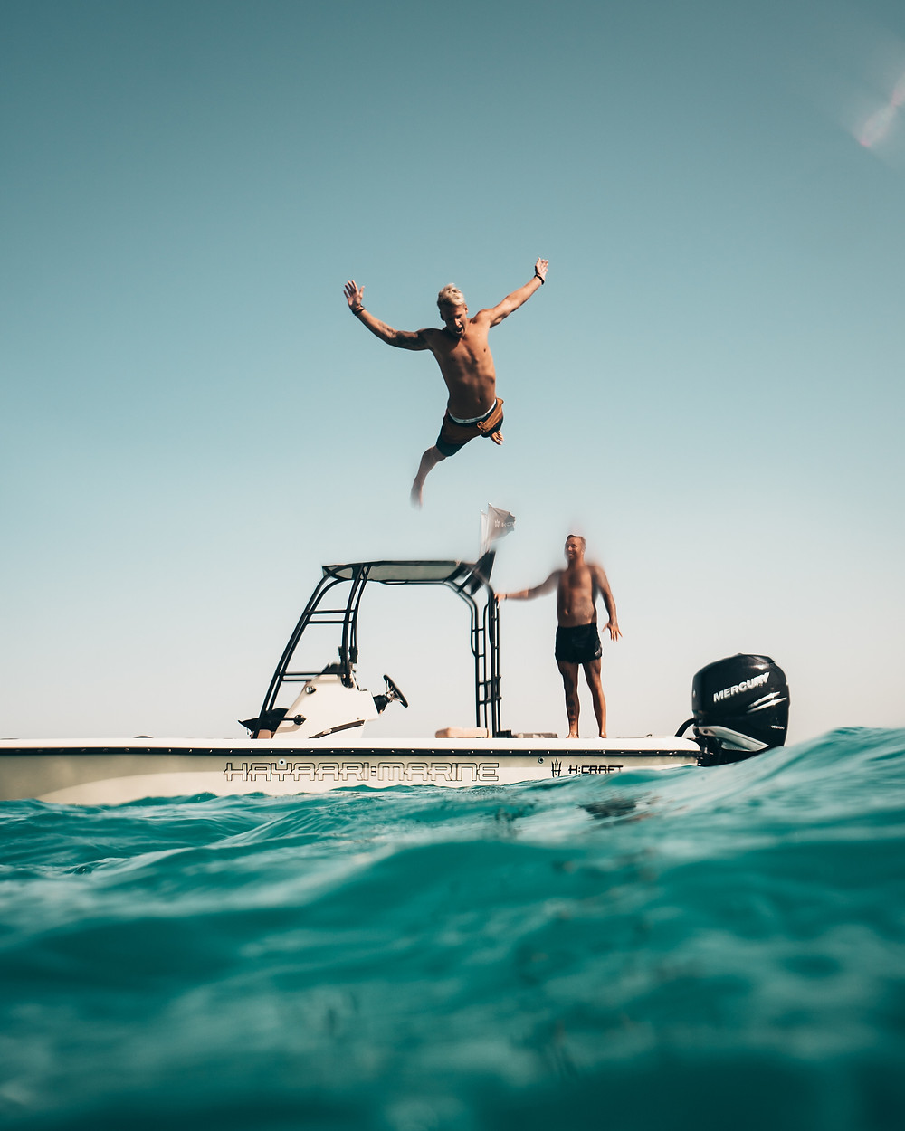 Jumping off boat in summer