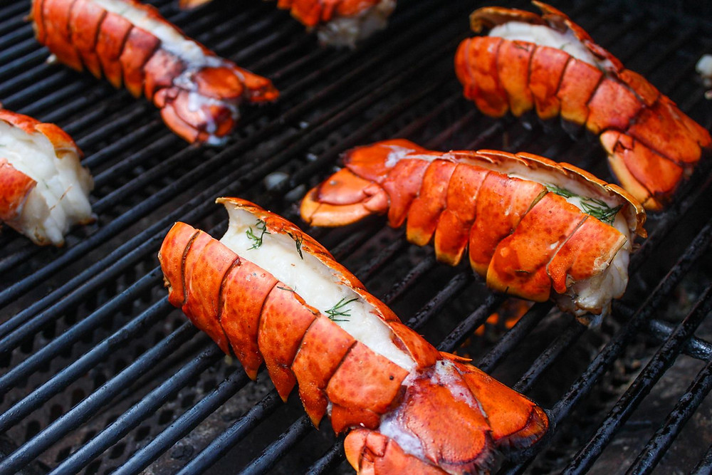 Lobster tail grilling on BBQ