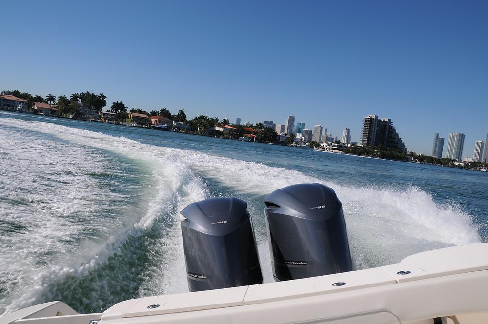 Dual engine racing boat cruising on lake