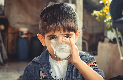 photo-of-boy-drinking-glass-of-milk-1210