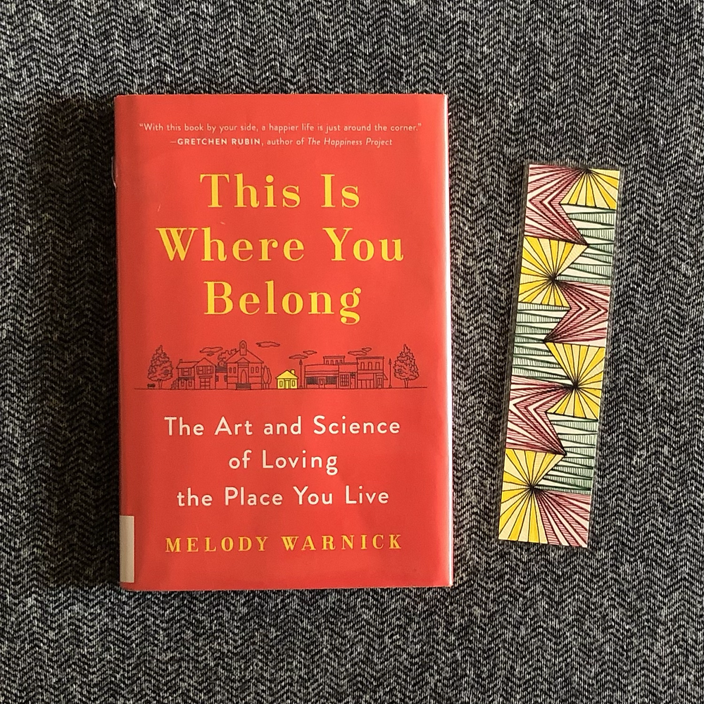 This Is Where You Belong by Melody Warnick with hand-drawn yellow, green, and red bookmark beside it