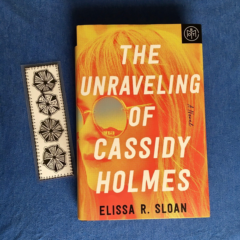 The Unraveling of Cassidy Holmes: A Novel, Elissa R. Sloan with blue background and bookmark