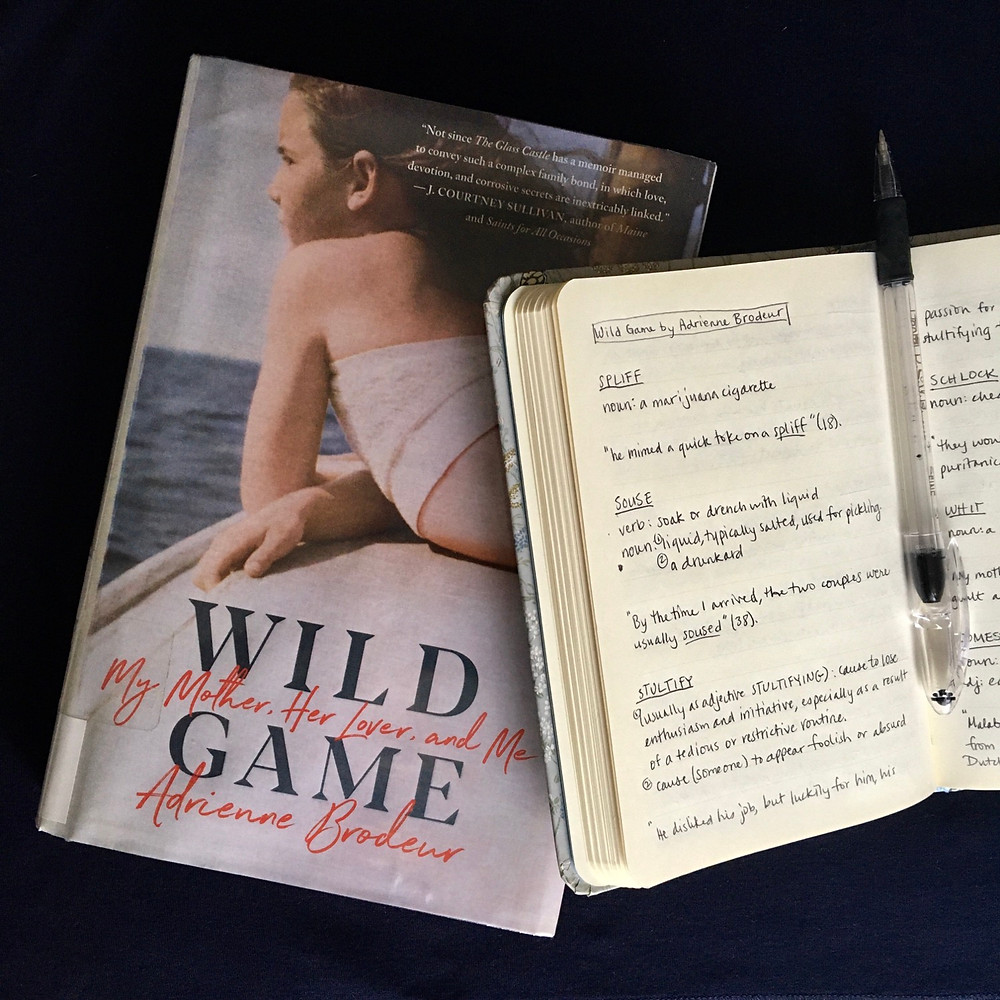 Open journal overlapping the book Wild Game by Adrienne Brodeur