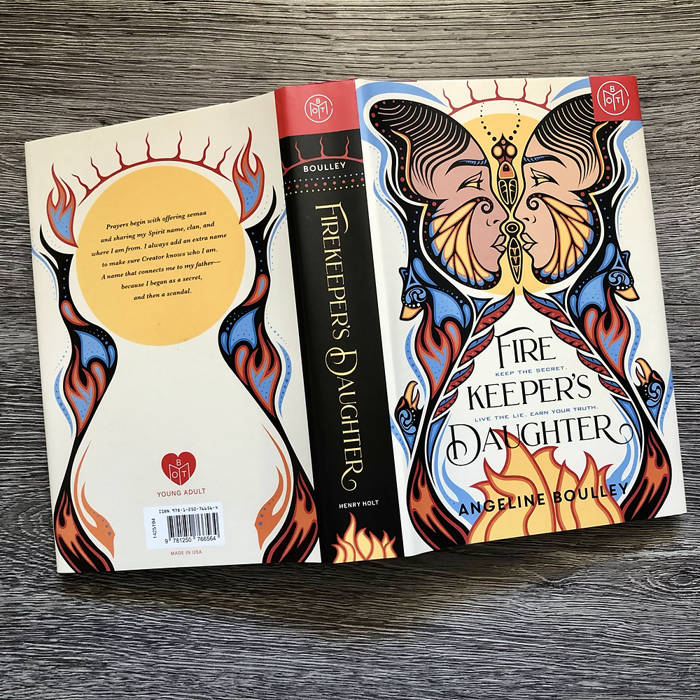 The Firekeeper's daughter by Angeline Boulley opened and flat so that front and back cover are shown together