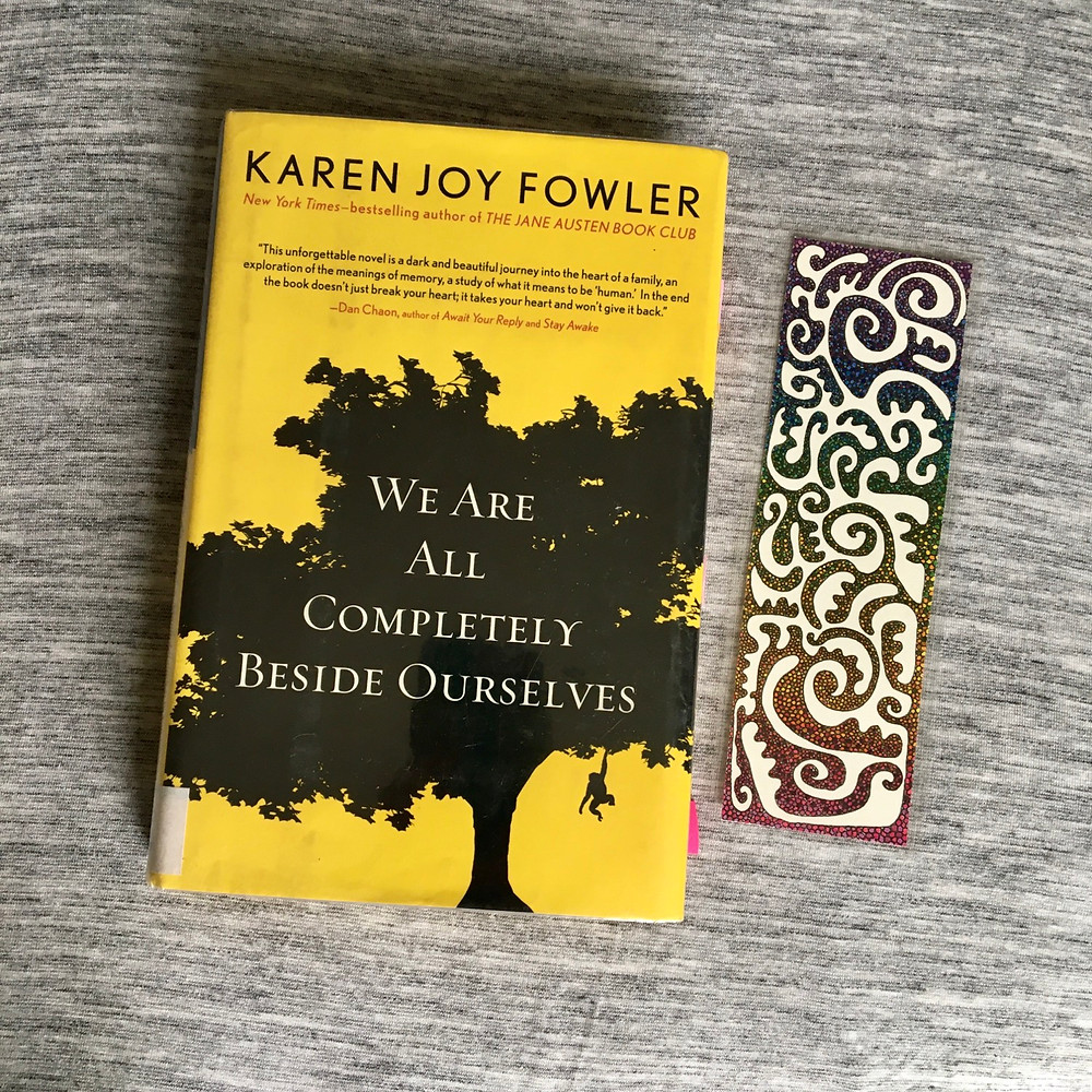 We are completely beside ourselves by Karen Joy Fowler book with bookmark