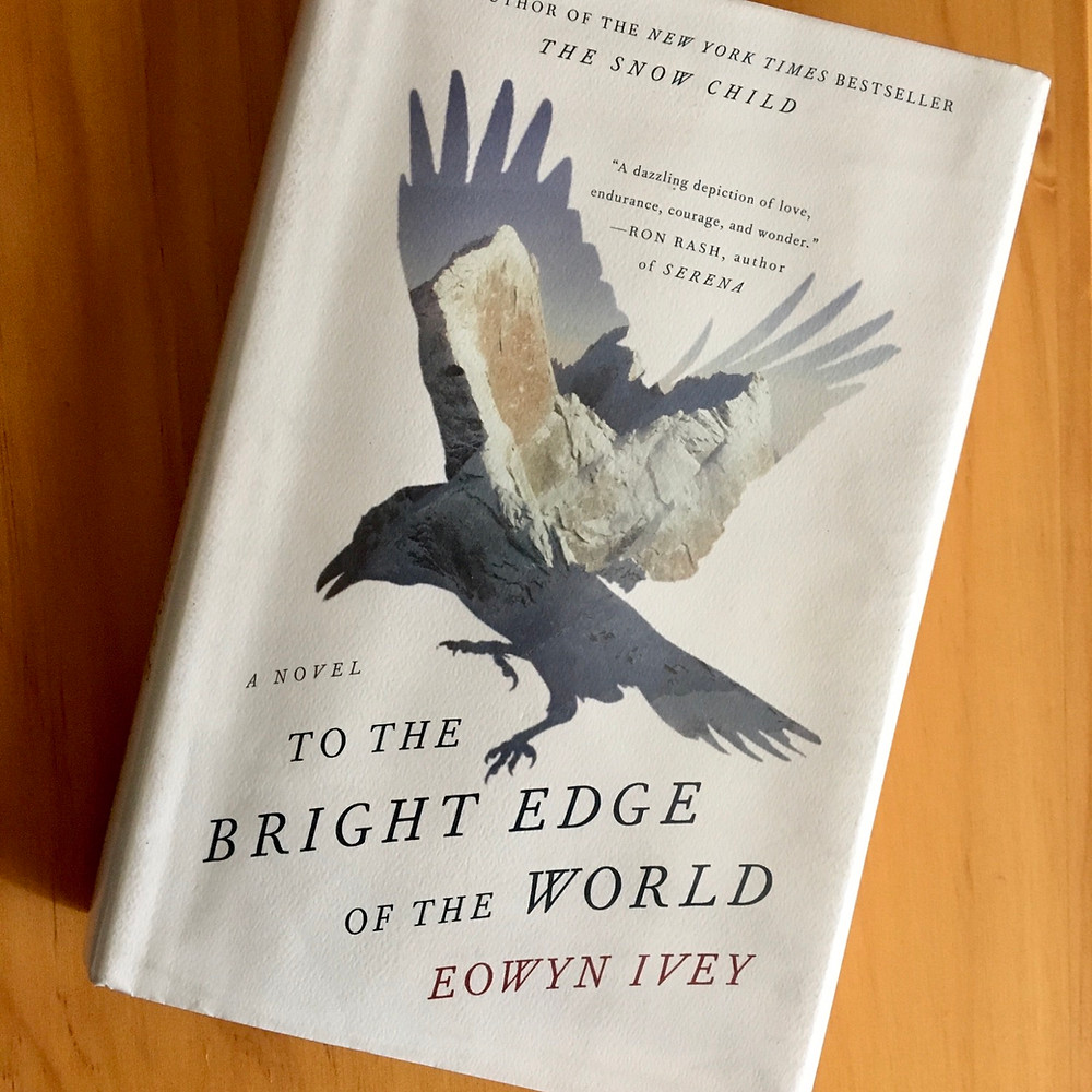 To the Bright Edge of the World by Eowyn Ivey with wood background