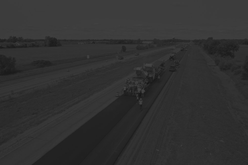 central-asphalt-team-paving-highway-black-and-white