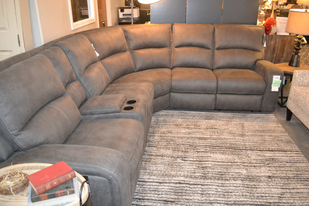 Relax with friends and family on this Flexsteel reclining sectional