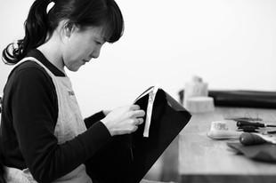 Hand sewing process by Ms. Fukasawa