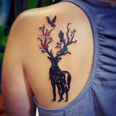 Deer antlers and flowers tattoo, Larissa Long