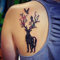 Deer antlers and flowers tattoo, Larissa Long