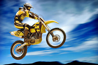 Motorbike and rider mid jump