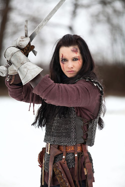 Woman in the medieval costume holding a sword.jpg