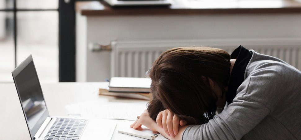 Woman puts head down with disappointment after being rejected for employment