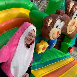 Jungle themed bouncy castle with slide