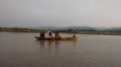 People on a boat to travel to a city nea