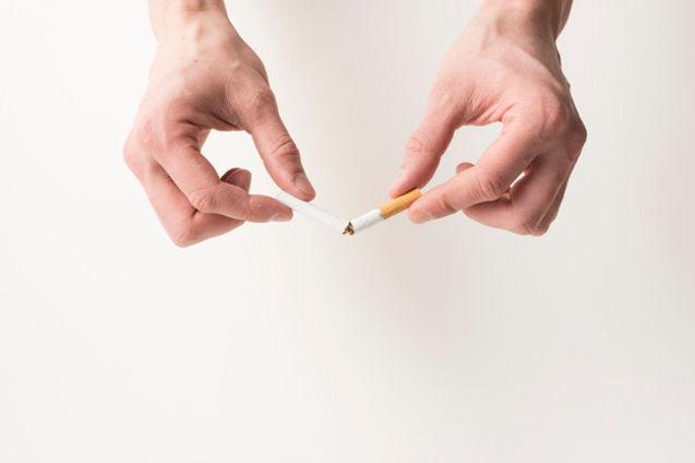 person-s-hand-breaking-cigarette-white-b