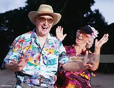 Mature Couple with Hawaiian Outfits.jfif