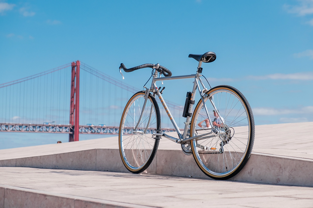 Stock image of bicycle with view of bridge in the background
