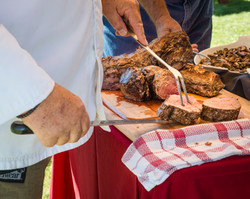 bigstock-Chef-carving-meat-74487109