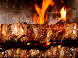 bigstock-Spit-Roast-With-Meat-Cooked-On-69066166