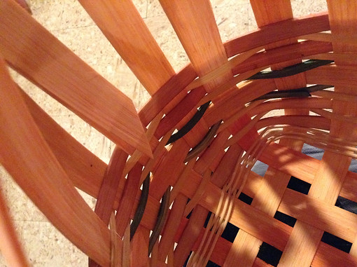 soak as needed and weave as high as you'd like to make the basket with room to tuck spokes down in to finish