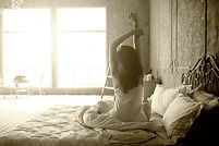 Sleep apnea patient awakening and stretching in bed in the morning