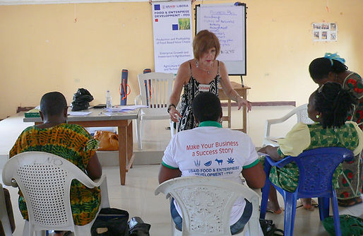 Donna Rosa teaching entrepreneurs in Liberia
