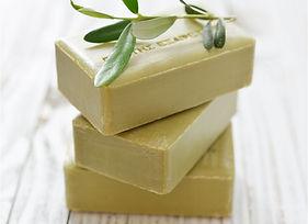 Three bars of handmade soap.