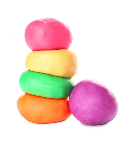 Colorful play dough on white background.