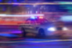 Police car speeding through traffic at n
