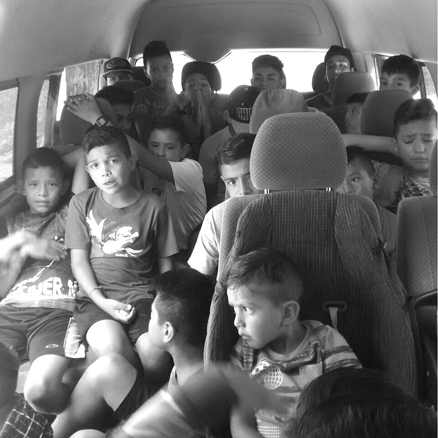 All boys are crammed into Hope House's 15 passenger van.