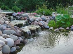 water fall into kio pond