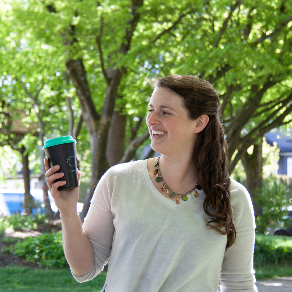 Our teammate Melanie holding a mugshare mug
