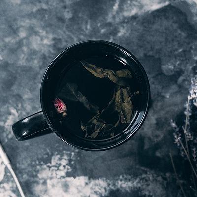 tea-in-black-ceramic-mug-near-apple-earpods-3473530_edited.jpg