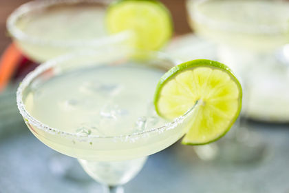 cold margarita in a glass with a wedge of lime