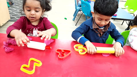Using alphabet cookie cutters with playdough